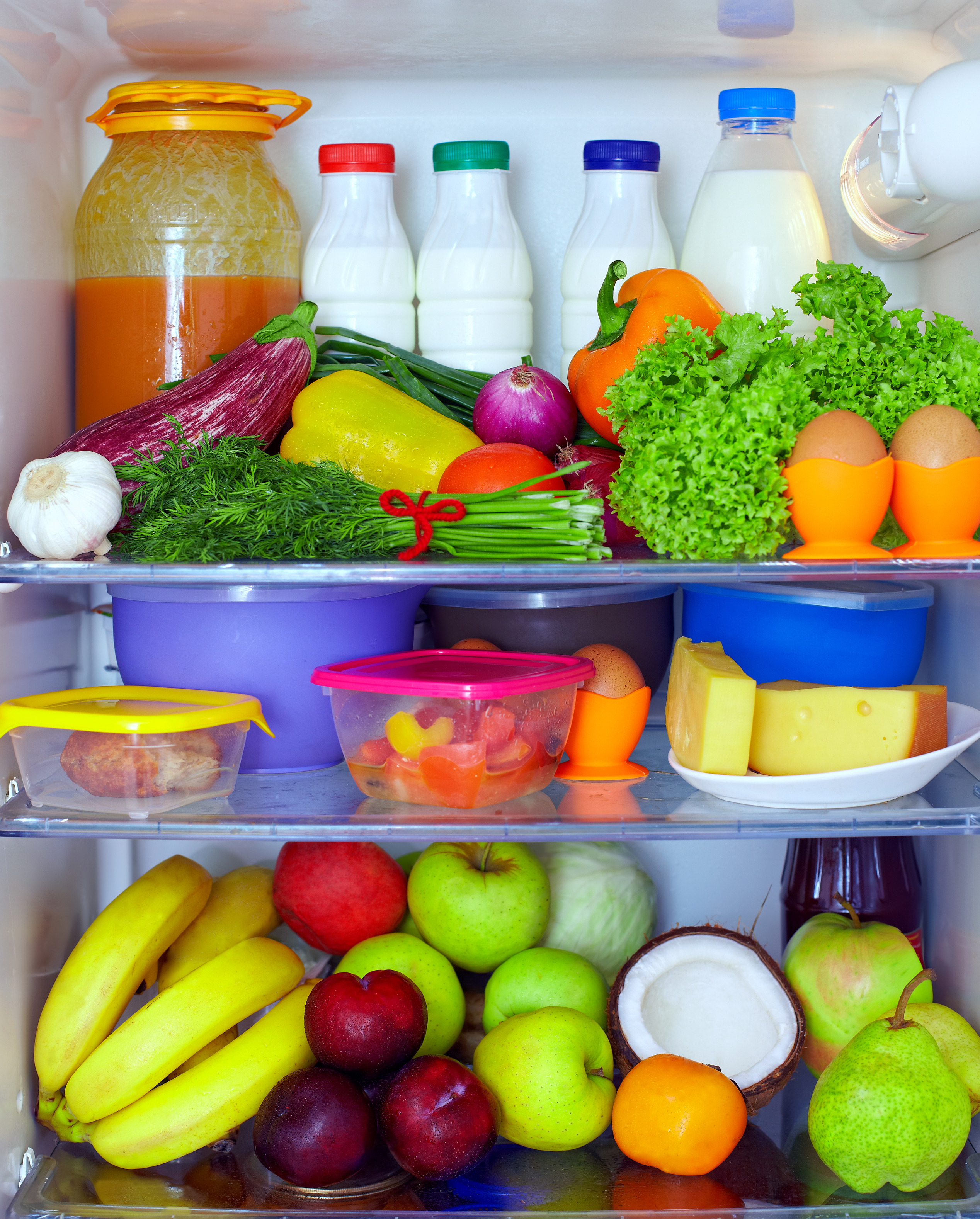 refrigerator full of healthy food. fruits, vegetables and dairy products